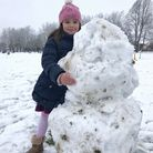 Julia Casamian, five, has not seen snow before - her parents, Elena and Domingo, come from Spain. He