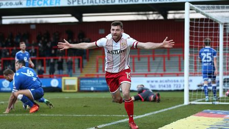 Danny Newton of Stevenage scores the first goal for his team and celebrates (pic Gavin Ellis/TGS Pho