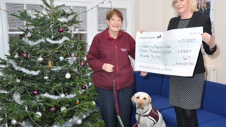 Hitchin Girls' School head Frances Manning hands over the charity cheque to Elizabeth Arendt from He