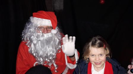 Ellen Robinson, 6, with her Paddington book.present from santa who visited the Leys Primary & Junio