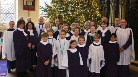 The Christmas tree on display at St Mary's Church in Hitchin with members of the choir gearing up fo