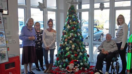 Residents and staff enjoy the completed tree that they worked together to create. Picture: Cassie L