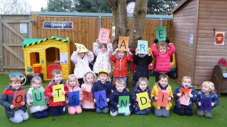 Children at Potton Pre-School spell out the words 'We are Outstanding' while celebrating in the wake