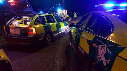 The Herts & Essex Air Ambulance team at the scene of the crash in Monkswood Way, Stevenage, with the