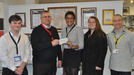 Shefford Christmas lights committee chairman Tony Goodwin receives the donation from Samuel Whitbrea
