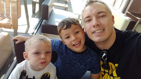 Damian with sons, Charlie, left, and Max, centre. Picture: Damian Davidson