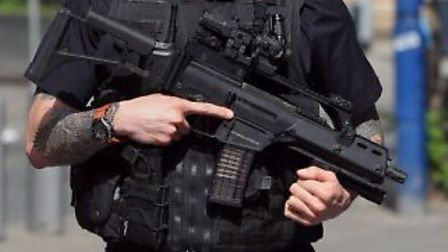 Armed officers and a police helicopter searched rushed to Hitchin's Redhill Road on Saturday.