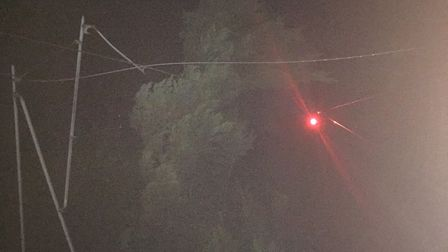 A large conifer tree was bown onto power lines near Meldreth. Picture: Network Rail