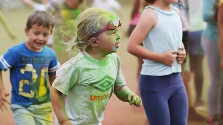 Anna Everett, 5 takes part in the colour run course at Roebuck Primary School. Picture: Danny Loo