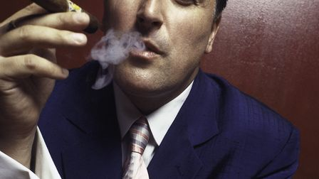 Ray Gelato smoking a cigar. Picture: Courtesy of Robin Campbell