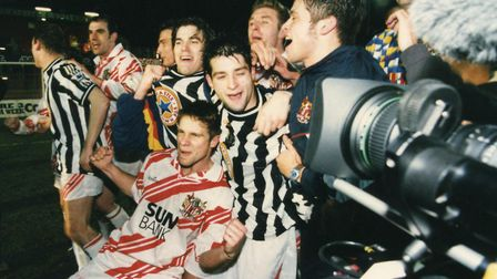Gary Crawshaw, front, and Stevenage team-mates celebrate after the 1-1 draw with Newcastle United. P
