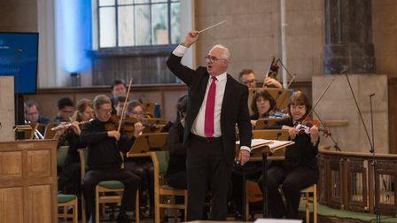 Noël Tredinnick directs the All Souls Orchestra, including violin tutor Ali Brown. Picture: Inspirin