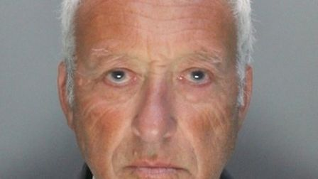 Clive Holmes has been sentenced to 14 months in prison for two counts of GBH against his wife. Pictu