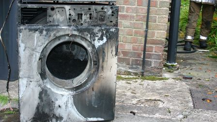 A burnt-out washing machine after a fire. Picture: Herts County Council