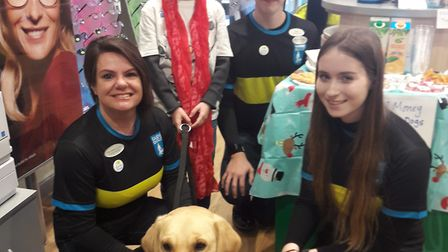 Biggleswade fundraisers Tracy Rook, Emmanuel Chapman and Alex Scholes with a guide dog and a young s