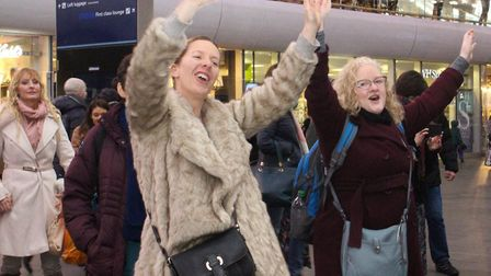 Passers by joined in for a sing a long at Sandy Ukulele Group's performance at Kings Cross station.