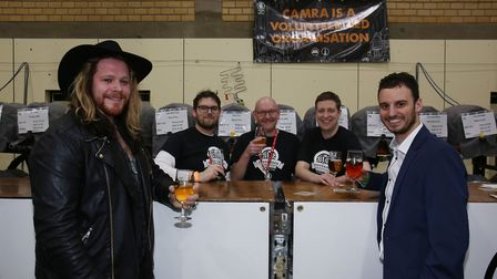 Stevenage Beer & Cider Festival organiser Jon Kirby (second from right) with CAMRA volunteers and Th