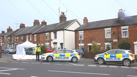Police at the scene of the stabbing, where Fishponds Road meets Bunyan Road in Hitchin.