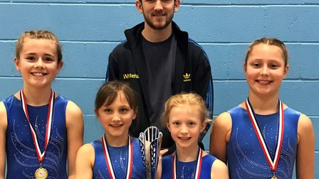 Whitehill Junior School gymnasts Sophie Beach, Eve Spencer, Hannah Cundell and Lola Barton with PE t