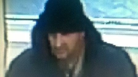 Police have released this CCTV image of a man they want to speak to after cash was stolen from a wom
