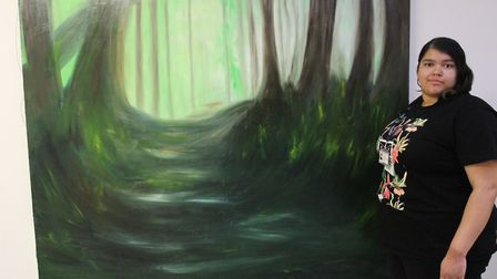 Jessica Cowsley with her oil canvas work, Enchanted. Picture: Jessica Cowsley