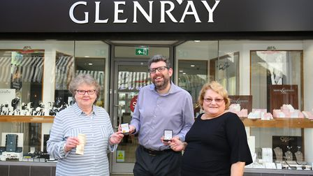 Glenray Jewellers owner Jason Cohen hands over the prizes to competition winners Pat Neal, left, and