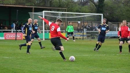 An action shot during the teachers' match between The Priory and Hitchin Boys' School last year. Pic