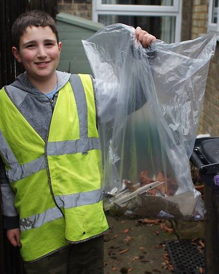 A proud youngster holds up some of the haul of rubbish at the Ickleford litter pick. Picture: Courte