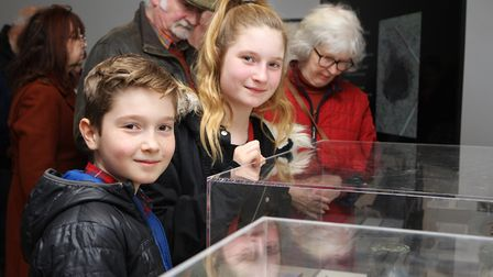 Nine-year-old Art Milligan and Clemmie Milligan 11, enjoy looking at the treasures. Picture: Karyn H
