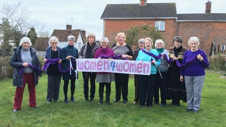 Women's rights campaigner Brenda Lowe (fifth from left) held a coffee morning to raise money for Wom