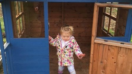 Kim Richardson's daughter Charlotte playing in the now-stolen playhouse. Picture: Kim Richardson