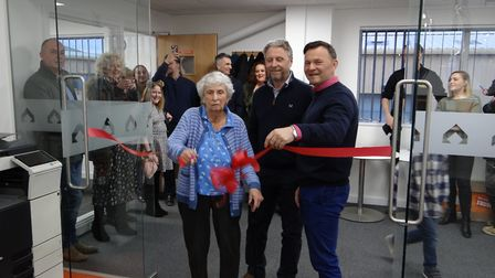 June Sharp, wife of DB Sharp founder Derek Sharp, formally opens the company's new headquarters at S