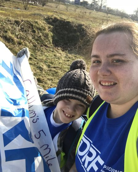 Callum Gibson and his mum Katie walked five miles in the freezing cold to raise money for a children
