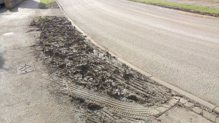 Damage done to a road verge by vehicles making their way to the Lucas Lane site. Picture: Michelle J
