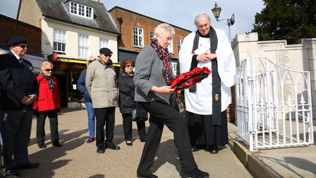 Brenda Preston lays a poppy wreath at a remembrance service held at Hitchin war memorial in memory o