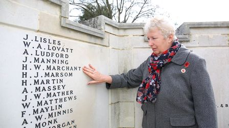 Brenda Preston at Hitchin war memorial next to the name of her grandfather Henry Walter Marchant who