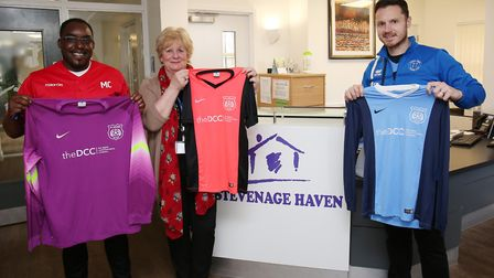 Stevenage Haven CEO Barbara Howard (second left) and Marc Campbell (far left) accept a donation of f