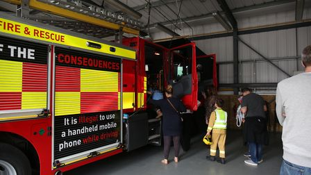 People waiting to sit in a fire engine at the Hertfordshire Fire & Rescue Longfield Open Day. Pictur