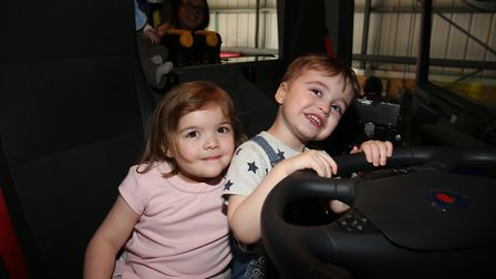 Eleanor Currington, four, and Oliver Offer, three, sit in a fire engine at the Hertfordshire Fire &