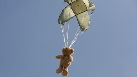 A teddy bear parachutes down from a high platform at the Hertfordshire Fire & Rescue Longfield Open
