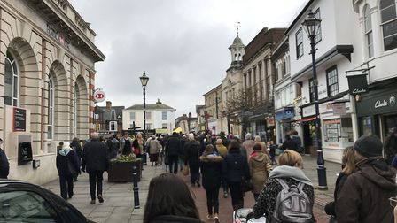 Hitchin's Good Friday Walk of Witness comes out of the High Street and into Market Place. Picture: D