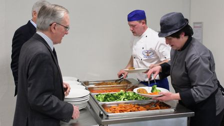 Stevenage school cook Michael Goulston serves his award-winning lunch to county councillors at Count
