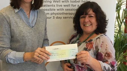 Corine (right) receiving her cheque from lottery manager Lisa Archer - finally! Picture: supplied by