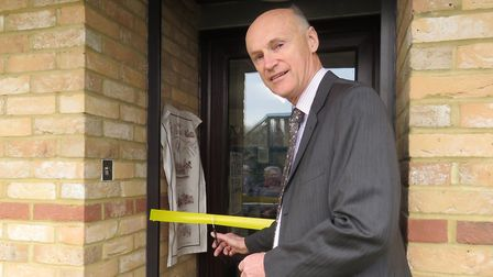 Potton Consolidated Charity chairman Charles Belcher cuts the ribbon on the new Potton History Socie