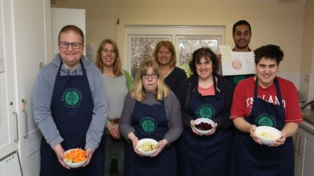 Triangle Community Garden Project manager Liz McElroy (back left and Nutritional therapist volunteer