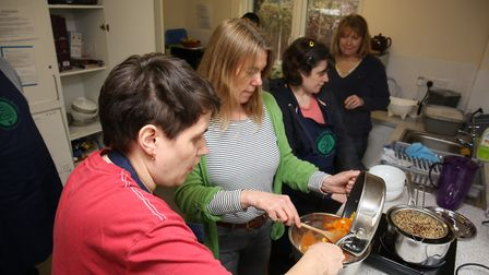 The Growing Health Group cooking in the kitchen at The Triangle Community Garden at Ransoms Rec in H