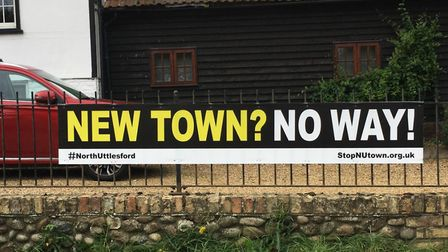 One of the banners put up by the campaign group. Picture: StopNUtown