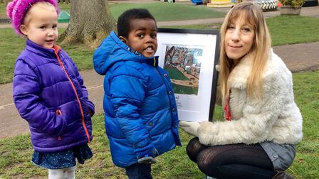 Artist Kim Raymont presents her print of the York Road Nursery School grounds to four-year-old Eliss
