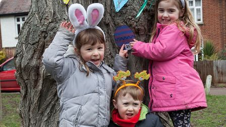 Younsters Ava Geldard, Will Alcorn and Issie Parry enjoying Ickleford pre-school's Easter egg hunt o