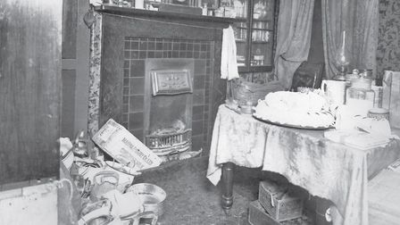 The rear living room where Mrs Ridgley was attacked. The bloodstained kettles and chamber pots on th